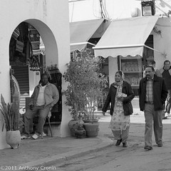 Waiting on a Sale: Souk, Tripoli Old Town (Anthony Cronin) Tags: 6x6 analog square photography all rights souk neopan agfa libya tripoli reserved folders agfaisolette xtol isolette foldingcamera 500x500 streetsphotography fujineopan greensquare solinar libyans agfaisoletteiii film:iso=400 kodakxtol film:brand=fuji formatfolding january2011 anthonycronin filmdev:recipe=5418 developer:brand=kodak developer:name=kodakxtol film:name=fujineopan400 iiicolor skoparmedium camera6x6120filmdevrecipe5418fuji neopankodak xtolfilmbrandfujifilmnamefuji 400filmiso400developerbrandkodakdevelopernamekodak tripolisouk tpastreet tripolioldtown analog streetphotographyagfa photangoirl