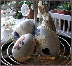 Egg keeper (Boxwoodcottage) Tags: white bunny easter happy golden dresden foil painted cottage eggs april greetings dried ostern pansies embellished hase 2010 boxwood violas papermach frhliche ostereier