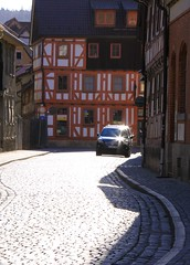 (:Linda:) Tags: street sun reflection car germany town timber thuringia cobblestone sonne sonnenstrahlen halftimbered fachwerk meiningen timberframing pflasterstein timberconstruction strase