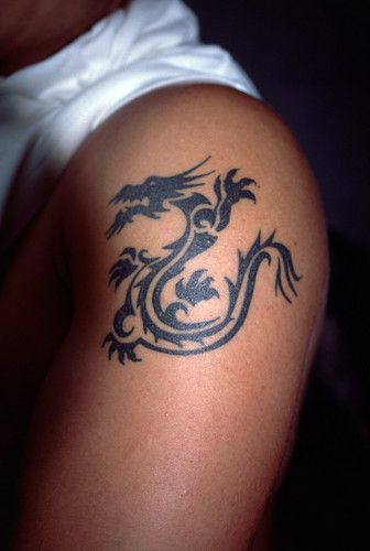 Dragon tattoo on a man's arm