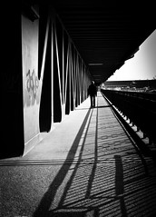 lonely walker - hamburg harbour (pamela ross) Tags: bridge shadow blackandwhite bw sun man pen germany walking harbour walk hamburg saturday olympus sw brcke ep1