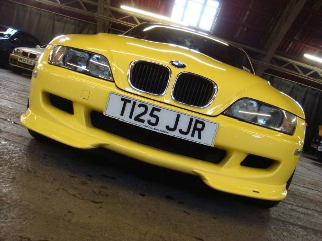 Dakar Yellow M Coupe with AC Schnitzer Type II wheels, AC Schnitzer Type II spoiler, AC Shnitzer splitters, AC Schnitzer pedals, AC Shnitzer ebrake handle, and Apline head unit