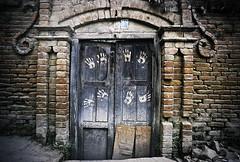 (Joshua Best) Tags: street wood nepal people colour brick film analog hands paint doors market candid doorway pentaxk1000 prints kathmandu handprints nepali 19mm