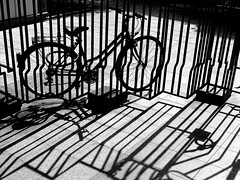 bike lines - ( explored ) (mujepa) Tags: blackandwhite bw france lines bike silhouette shadows noiretblanc curves nb portal bicyclette lorraine vlo metz lignes ombres portail blackwhitephotos mygearandme