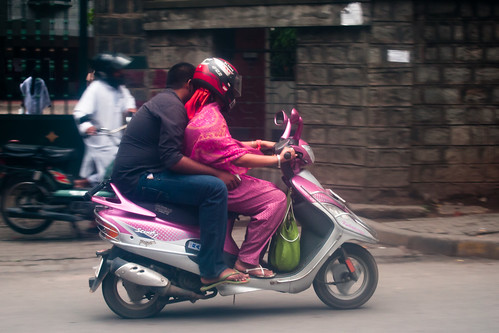 Scooter rider and passenger in Bangalore