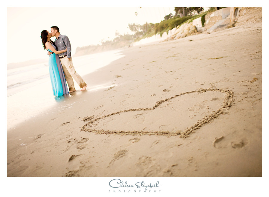 heart in sand engagement portrait