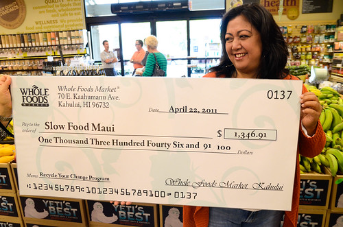 Slow Food Maui Treasurer Charlene Ka'uhane with the check to Slow Food Maui from Whole Foods Kahului Recycle Your Change Program. Photo credit: Peter Liu, Kaiscapes Social Media Consulting