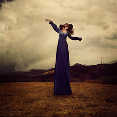 losing power in the wind (brookeshaden) Tags: mountains girl beautiful field grass hat clouds whimsy power wind surrealism creative straw surreal blowing powerlines powerline tall lovely telephonepoles whimsical schön utilityline brookeshaden texturesbylesbrumes