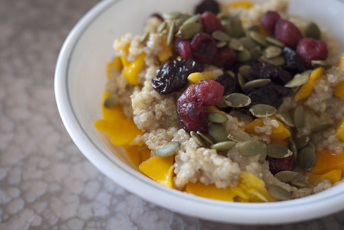 Breakfast Quinoa with Mango, Dried Fruit & Pumpkin Seeds