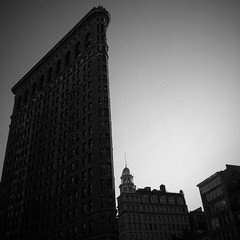Flatiron Building • NYC … an iPhone 4 photo by Dominique James, visit http://bit.ly/5HY4wN for more. (Dominique James) Tags: city sunset sky urban blackandwhite bw usa newyork news building art silhouette architecture photography design lab artist photographer rooftops tech manhattan unitedstatesofamerica picture shapes style historic spire talent filipino artdeco watertank att pictureshow diptic dominiquejames iphone4 camtastic bestcamera pixelpipe adobephotoshopexpress prohdr lomob vintbw iphoneography hipstamatic perfectlyclr instagram infinicam