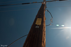 Electric Post (Zhenwu86) Tags: wood blue sky sign yellow electric danger nikon glow shine post wires upward d90