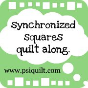 synchronized squares quilt along button.