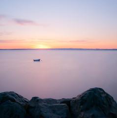 Feeling lonely at sunset (Yannick Guyader) Tags: ocean longexposure sunset sea sky mer france photoshop landscape roc boat nikon purple bretagne ciel brest bateau paysage rochers couchdesoleil lightroom poselongue plougastel d5000 guyader yannickguyader wwwyannickguyaderfr