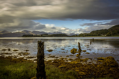 Over the Loch. (Ian Emerson) Tags: loch scotland scottish water posts reflection clouds mountains vegetation castle heritage 1855mm hoya ndx400 omot landscape outdoor nature beauty
