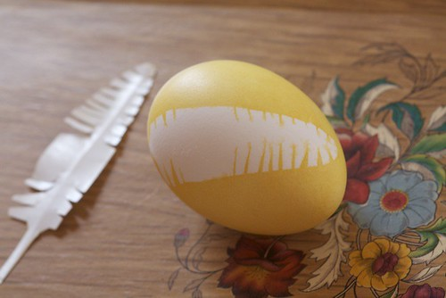 yellow egg with feather