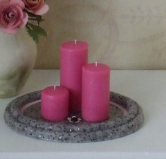 Pink candles on tray