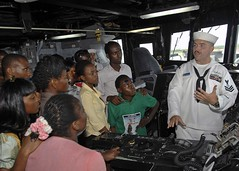 Sailor explains the function of the ships helm to Nigerian NGO workers. (Official U.S. Navy Imagery) Tags: navy lagos nigeria sailor usnavy aps guidedmissilefrigate ussixthfleet africapartnershipstationwest usnavalforceseuropeafrica ussrobertgbragleyffg improvemaritimesafetyandsecurity