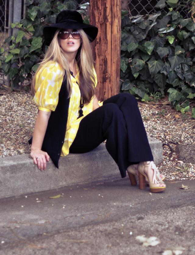 60s 70s look, wide leg pants, platform shoes, yellow and black, vest, sunglasses