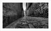 una strada antica (Andrea Rapisarda) Tags: street old italy texture vanishingpoint nikon strada italia stones details sigma antica pietre sicily 1020mm rue 169 sicilia biancoenero erice puntodifuga d7000 andrearapisarda