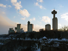 Canadian Niagara Skyline (Diego3336) Tags: winter sunset urban usa snow ny newyork ontario canada ice nature water silhouette sign rock stone skyline america skyscraper river niagarafalls frozen waterfall rocks frost cityscape stones bor