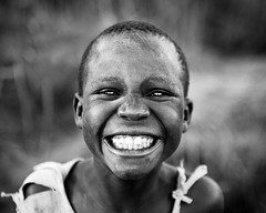 S M I L E  - DR CONGO - (C.Stramba-Badiali) Tags: poverty africa portrait people blackandwhite girl beauty smile face look closeup rural square person eyes village child noiretblanc expression teeth joy culture human blackpeople environment remote tradition shavedhead ethnic enfant fille glance humanbeing complicity dents humanitarian oneperson drc bunia visage regard carr africain afrique zaire displaced rdc drcongo africanchild blackchildren blackskin centralafrica ethno lookingatthecamera gety ethnie ituri peaunoire afriquecentrale lendu 5dmkii tterase forgottenconflict strambabadiali