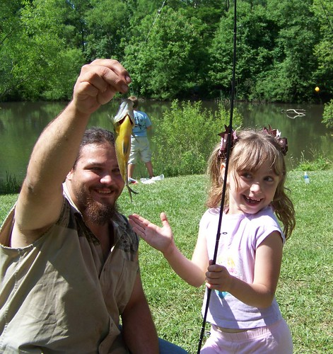 young girl showig off her fish catch
