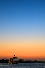 into the dusk (Eric 5D Mark III) Tags: california blue sunset sky orange usa yellow vertical ferry canon river landscape photography canal twilight unitedstates dusk newportbeach gradient orangecounty balboaisland ericlo ef24105mmf4lisusm eos5dmarkii