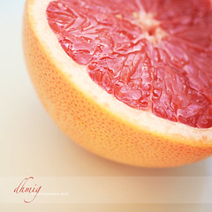 Pink grapefruit (dhmig) Tags: summer orange closeup fruit nikon outdoor juice details naturallight grapefruit peel 50mmf28 pinkgrapefruit seasonalfruit juiciness nikond7000 dhmig dhmigphotography