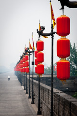 Xi'an Afternoon Bike Ride (Amicus Telemarkorum) Tags: china old red man bike wall cycling ancient afternoon cloudy chinese xian biking lanterns touring shaanxi citywall captial jeffrueppelphotography