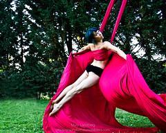 Greatest of Ease (landbergmary) Tags: marylandberg conceptualphotography conceptualportrait portrait brave courageous puttingitoutthere uninhibited fearless aerialdancing beautifulwoman redsilk swinging flying bluehair