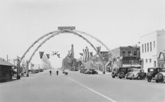 Pacific Coast Highway at Main St., Huntington Beach (Orange County Archives) Tags: orangecountyarchives orangecounty orangecountyhistory history historical california southerncalifornia huntingtonbeach pacificcoasthighway pch downtown mainstreet arches
