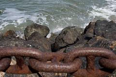 Rocks and water (digiteyes) Tags: sanfrancisco rocks waves bayarea seawater presidiopark ironlinkfence ggnpc11