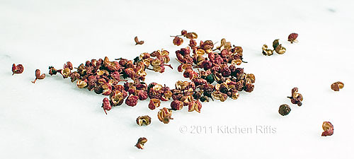Sichuan Peppercorns on a marble slab