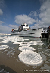 Fishtown ... frazil/pancake ice, circulating (Ken Scott) Tags: winter usa selfportrait ice marina leland march spring michigan fishtown selfie leelanau mishemokwa pancakeice backpage kenscott fhdr earthsciencepictureoftheday lelandriver frazilpan islandferryboat lilypadice