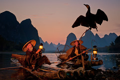 Cormorant Fishermen at Dusk ~ Guilin ~ China ~ Photography ~ Nikon ~Landscape (Dan Ballard Photography) Tags: china travel fish mountains water river photography photo nikon asia gallery fishermen pics guilin flash images bamboo raft gel sb800 offcameraflash cormorantbirds cormorantfishermen