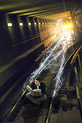 Lost in a book (Noel Bass) Tags: art electric train photoshop subway reading book graphics metro angeles bass tracks surreal tunnel noel shock lightning conceptual charge current effx