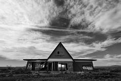 We Are Here (Mike Olbinski Photography) Tags: clouds blackwhite northernarizona circularpolarizer abandonedbuildings twoguns tamron1735mm28 canon5dmarkii 20110402