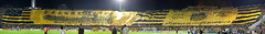 Panoramic Photo: Peñarol unfurled at Centenario Stadium a 309 meters long, 46 wide,  1,880 kg flag, covering 30,000 fans; the largest team flag ever created that could make it to the Guiness Book of records. Must view original version to enjoy!