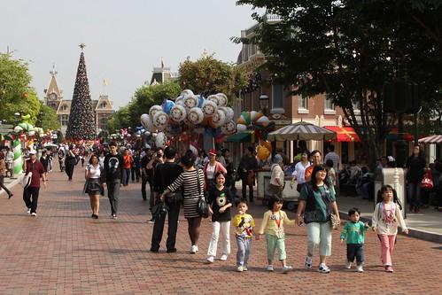 Family wandering down Main Street USA