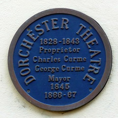 Photo of Dorchester Theatre, Charles Curme, and George Curme blue plaque