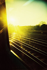 Heading home (Monkey Tennis) Tags: uk sun film train 35mm xpro crossprocessed glare iso400 swindon railway slidefilm line worklifebalance vivitart200 fujisensiaii400rh