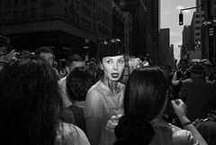 face in the crowd. (Vitaliy P.) Tags: new york city nyc portrait people woman white black monochrome lady vintage mouth lens dance costume outfit big eyes nikon open dress dancing manhattan candid flash crowd sb600 midtown gothamist kit avenue 5th speedlight viel fifth 2011 d80 18135mm easterdayparade vitaliyp