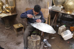 Metal worker in Berber Souk (susanreep) Tags: boy morocco marrakech medina metalworking boyworking metaltray berbersouk