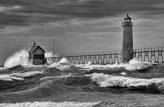 Grand Haven Lighthouse  - Grand Haven, Michigan (Michigan Nut) Tags: blackandwhite usa storm art waves lakemichigan grandhavenlighthouse michigannutphotography nikonnikkor70300mmf4556gedifafsvrtelephotozoomlens