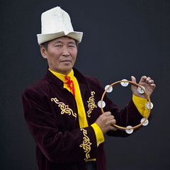 Man with Kalpak Hat Playing Tambourine, Kyrgyzstan (Eric Lafforgue) Tags: people man male hat standing square person one asia interior pasture tambourine centralasia kyrgyzstan humanbeing nomads oneperson traditionaldress 1643 colorphoto musicinstrument headgear kyrgyzrepublic kirghizistan kirgistan kalpak lookingatcamera traditionalclothes waistup kirghizstan kirgisistan traditionalhat calpack  calpac nomadiclifestyle   traditionalheadgear saralasazjailoo quirguizisto kalpakhat kalpac qalpaq
