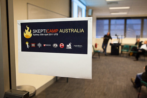 Skepticamp Sydney 2011 sign, posted on a clear glass door