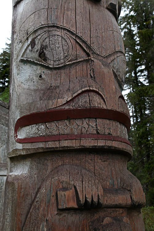 wet figure on totem, Kasaan, Alaska