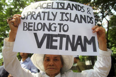 A woman holds a placard supporting Vietnam in a protest demanding China to stay out of their waters following China's increased activities around the Spratly Islands and other disputed areas, in Hanoi, Vietnam on June 12. by Pan-African News Wire File Photos