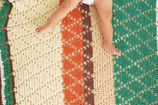 soulie and crocheted blanket