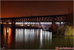 Puentes metlicos sobre el Duero (Ana_Lobo) Tags: longexposure bridge espaa water night ro canon reflections river spain agua bridges nocturna puentes zamora reflejos ferrocarril hierro duero castillaylen rutadelaplata 450d metlicos